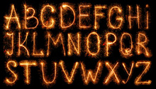 Alphabet Made Of Sparklers Isolated On Black