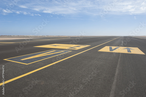 Directional sign markings on a runway Canvas Print