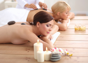 Obraz na płótnie Canvas Two young beautiful women relaxing and enjoying at the spa center