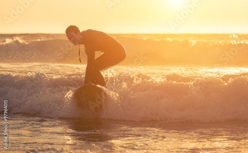 Staande foto Meloen Surfer performing tricks on the waves