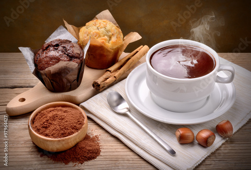 Foto op Plexiglas Chocolade Hot chocolate and muffins