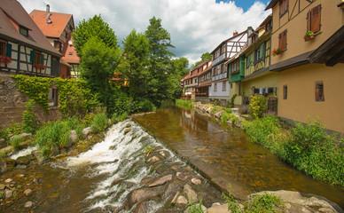 Fototapeta na wymiar Stream through a town in summer