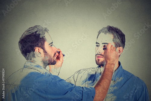 Create yourself concept. Good looking young man drawing a picture, sketch of himself