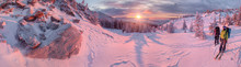 Skiers Watching Sunrise In Winter Mountains