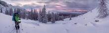 Skier Watching Sunrise In Winter Mountains