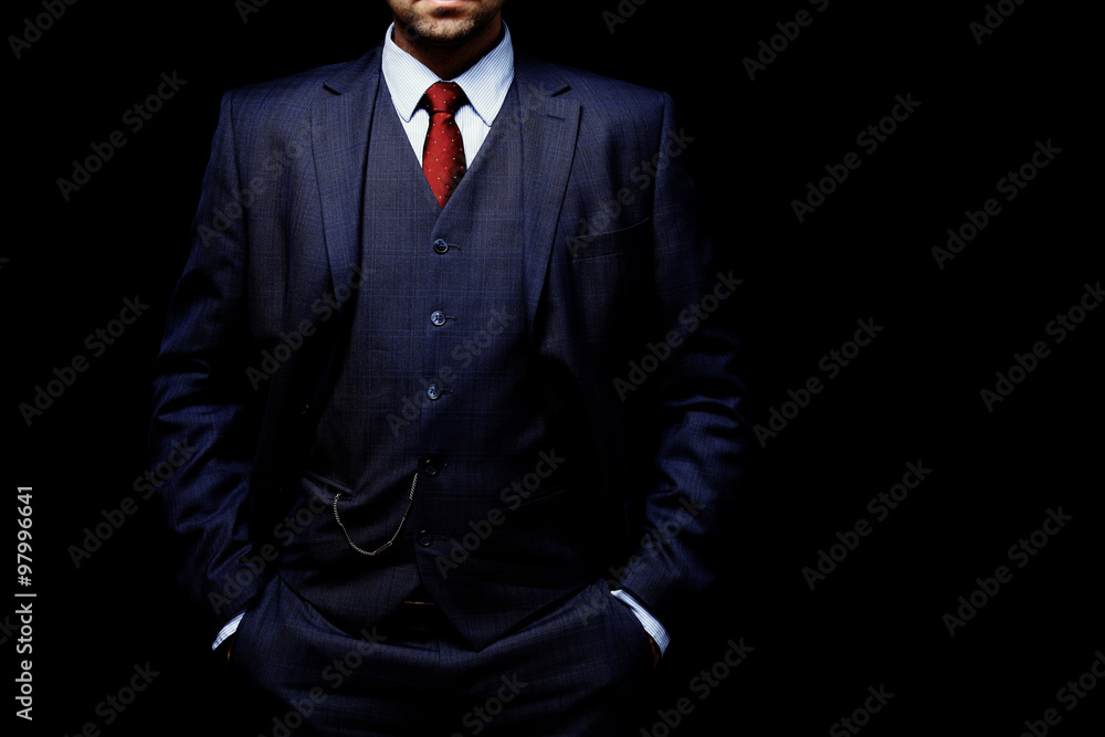 Fototapeta man in suit on black background