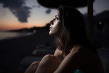 Woman Watching The Ocean,sea Horizon With A Moon On The Sky.Eclipse Of The Moon.Eclipse Of The Sun.Stargazing,watching Stars On The Beach Under The Moonlight.Enjoying Summer Nights.Night Sky.Sunrise