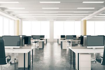 Modern open space loft office with furniture, concrete floor, bi