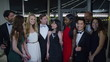 Portrait of attractive mixed ethnicity group of friends at glamorous party