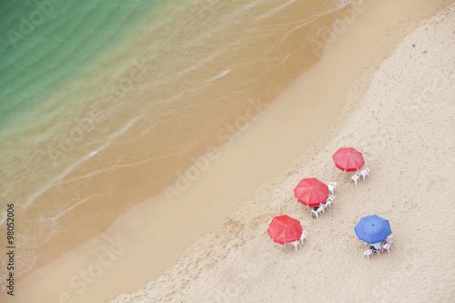 Fotografija  Looking down at umbrellas and cabanas on a beach