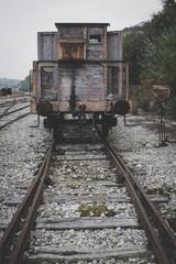 Fototapeta na wymiar Old and abandoned cargo train
