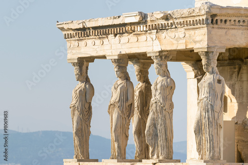 Photo Stands Athens Caryatids statues at Acropolis in Greece.