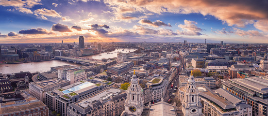 Panoramic skyline view of south and west London at sunset with beautiful clouds.