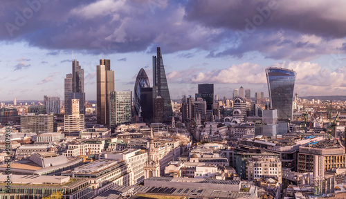 Poster London Skyline of Business district of London with dark clouds and Canary Wharf at the background