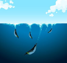 Penguins Swimming Under The Oc...