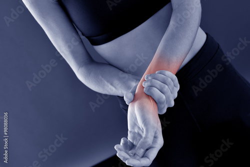 Athletic girl and painful wrist, isolated Canvas Print