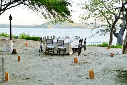 A romantic table set for dinner on the beach