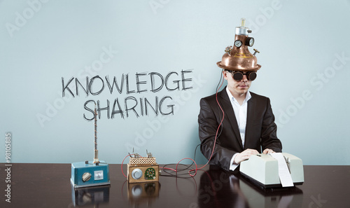 Fotografie, Obraz  Knowledge is sharing concept with vintage businessman and calculator