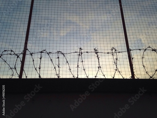 Barbed wire wall with fence