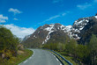 Asphalt road to Norvegian mountains in clear day