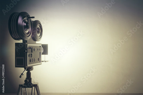 Old style movie camera with white wall, vintage photo effect Canvas Print