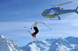 ski jumper being filmed from a helicopter
