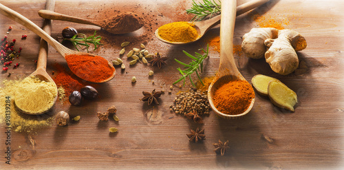 Printed kitchen splashbacks Spices Spices and herbs on a wooden background.