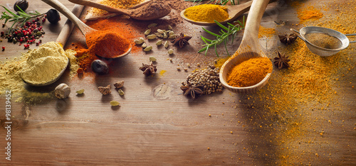 Foto op Plexiglas Kruiden Various spices and herbs on wooden board.