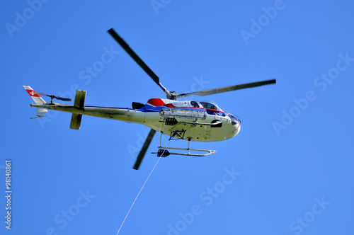 Tuinposter Helicopter helicopter with lifting cable