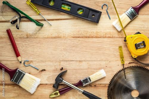 Carpenter tools on wood board