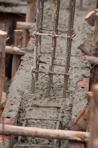 Fototapeta pillar and beam being constructed at construction site obraz na płótnie