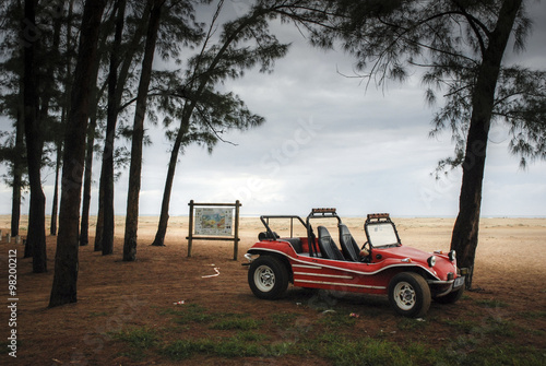 Foto op Plexiglas Retro Vintage dune buggy on the coast of South Africa just after dawn.
