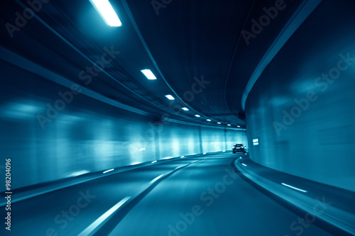 Papiers peints Tunnel Motion blurred blue colored tunnel high speed car driving. Motion blur visualizes the speed and dynamics. Personal perspective used.