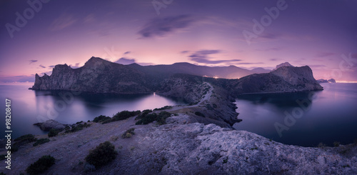 Fotobehang Landschap Beautiful night landscape with mountains, sea and starry sky