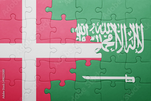 Photo  puzzle with the national flag of saudi arabia and denmark
