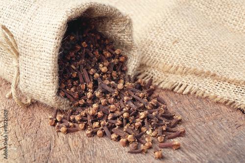 Fotografie, Obraz  Aromatic dried clove flower buds in sackcloth bag