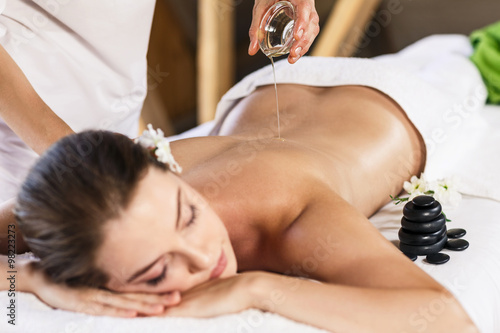 Woman enjoying massage. Poster