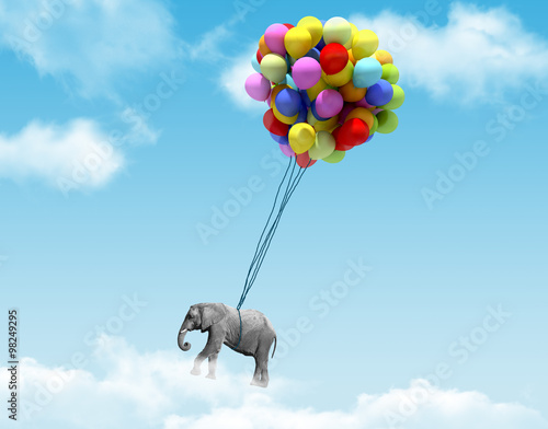 Foto op Aluminium Olifant An elephant being lifted by balloons