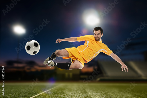 Photo  Soccer Player kicking the ball