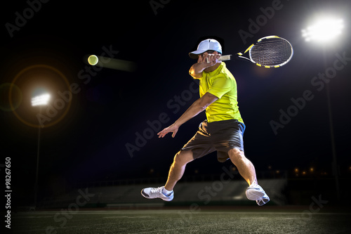 Tennis player during a match at night