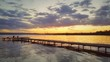 Beautiful sunset over the lake and sea jetty
