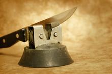 Old Kitchen Knife And Sharpener