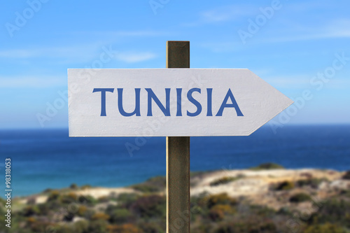 Staande foto Tunesië Tunisia sign with seaside in the background