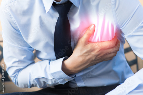 Fotomural Man in office uniform having heart attack / heart burn with red spot