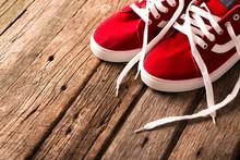 Vintage Hanging Shoes On Woode...