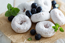 Powdered Sugar Donuts On Parch...