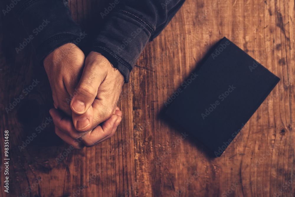Fototapety, obrazy: Christian man praying with hands crossed