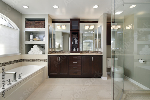 Fotografie, Obraz  Master bath with dark wood cabinetry