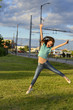 Surprised girl jumps high next to a road outside .