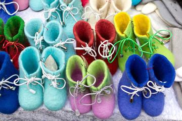 Fototapeta na wymiar Selling shoes of felt